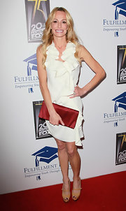 Taylor Armstrong showed off her satin clutch while hitting the Stars Benefit.