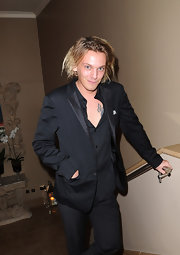 Jamie Campbell Bower toned down the formality of his black tux by pairing it with an unbuttoned down-to-there shirt.