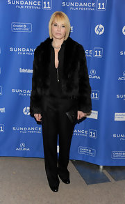 Ellen dons sleek black pants with her evening ensemble.