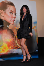 Evangeline Lilly polished off her look with black ankle-strap platforms.