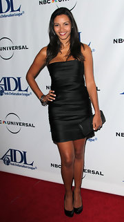 Jessica Lucas used a black leather clutch to complete her dressy outfit at the Anti-Defamation League Awards Dinner.