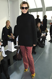 Yasmin Le Bon opted for red polka dot slacks and fun yellow shoes to add some color to her Fashion Week look in London.