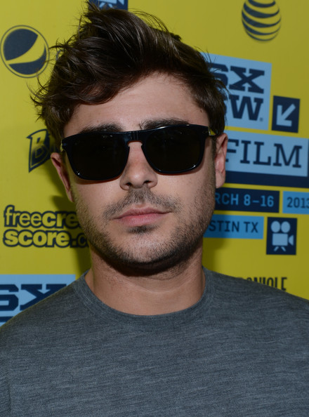Zac Efron's carefree look was topped off by these basic black wayfarers.