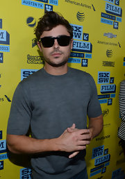 Zac Efron kept his red carpet look super casual with a gray basic tee.