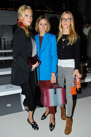 Poppy Delevingne donned a cute pair of heart-print calf-hair loafers by Burberry for the Anya Hindmarch fashion show.