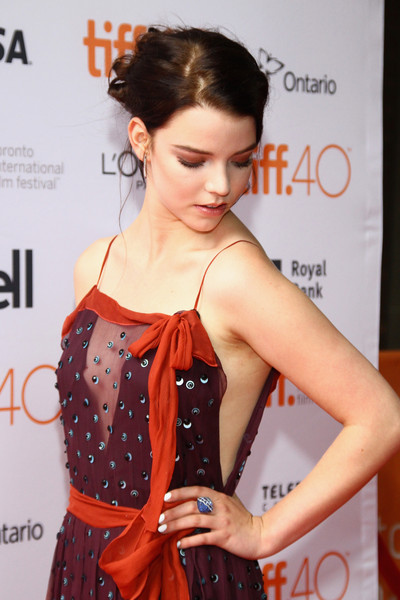 Anya Taylor-Joy Statement Ring [the witch,hair,clothing,hairstyle,shoulder,dress,skin,fashion model,fashion,long hair,premiere,anya taylor-joy,photo call,toronto,canada,ryerson theatre,toronto international film festival,premiere]