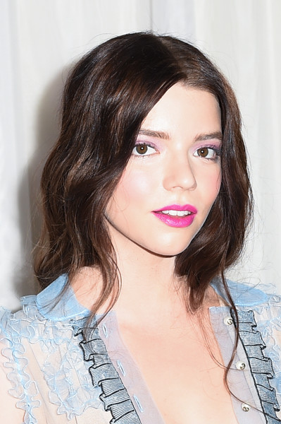 Anya Taylor-Joy Long Wavy Cut [the witch,hair,face,hairstyle,lip,eyebrow,beauty,chin,brown hair,skin,shoulder,anya taylor joy,california,hollywood,arclight cinemas,a24,red carpet,premiere]