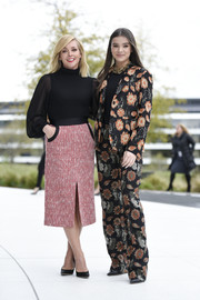 Hailee Steinfeld was blooming in a floral pantsuit by Ferragamo at the Apple product launch event.