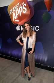 Jessica Alba layered a gold satin duster by Galvan over a navy slip dress for the Planet of the Apps party.