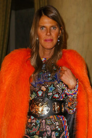 Anna dello Russo shone at the Aquilano Rimondi fashion show in a beaded dress cinched with an embellished oversized belt.