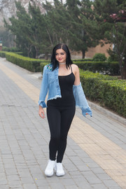 Ariel Winter paraded her famous curves in a black catsuit while out in Beijing.