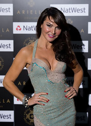 Lizzie Cundy arrived at the Ariella Couture fashion show with her nails polished a classic red shade.