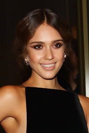 Jessica Alba wore dramatic sweeps of metallic bronze shadow at the opening of Armani Hotel Milano.