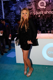 Amanda stood tall at Fashion Week in silver YSL sandals.