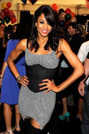Ciara paired her black-and-white dress with radiant red nail polish.