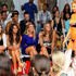 Model Kate Upton walks the runway at the Beach Bunny Swimwear show while model Christine Teigen (second from left) watches during Mercedes-Benz Fashion Week Swim on July 15, 2011 in Miami Beach, Florida.