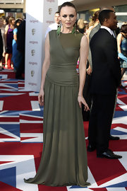 Laura Haddock cut a glamorous figure in her khaki floor-grazing gown on the 2012 BAFTA's carpet.