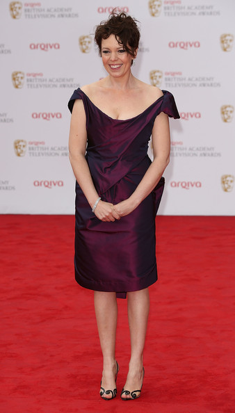 Olivia Colman chose a more classically sophisticated red carpet look when she opted for this eggplant-colored off the shoulder cocktail dress.