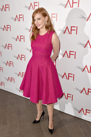 Jessica Chastain brought a heavy dose of sweetness to the AFI Awards with this fuchsia fit-and-flare dress by Lela Rose.