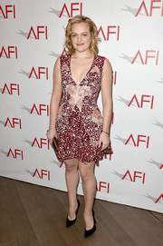 Elisabeth Moss showed her flirtier side at the AFI Awards in a Stella McCartney frock featuring a cleavage-baring neckline and a busy print.