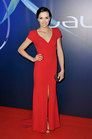 Victoria Pendleton opted for a sleek red dress with cap sleeves and a front slit for her red carpet look.
