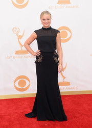 Amy chose a black gown with embellished pockets and a sheer top overlay.