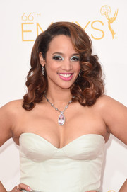 Dascha Polanco finished off her colorful beauty look with a pretty pink lip.