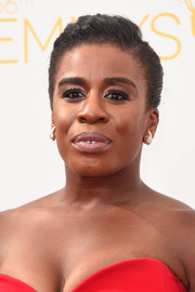 Uzo Aduba slicked her hair back into a side-parted bun for the Emmys.