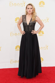 Kate McKinnon was goth-glam at the Emmys in a black J. Mendel gown with a mesh bodice and a deep-V neckline.