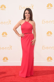 Julia Louis-Dreyfus was svelte and elegant at the Emmys in a red Carolina Herrera halter gown.