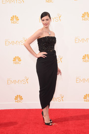 Jessica Pare opted for a sophisticated black Lanvin strapless dress, featuring a beaded bodice and a tulip skirt, when she attended the Emmys.