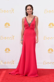 Minnie Driver kept it timeless on the Emmys red carpet in a crimson Marchesa gown with a bejeweled deep-V neckline.