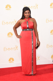 Mindy Kaling made an edgy-glam statement at the Emmys in a red Kenzo halter gown with silver accents.