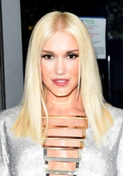 Gwen Stefani attended the Emmys wearing an impossibly sleek center-parted hairstyle.