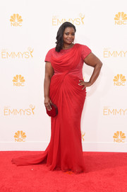 Octavia Spencer turned to her favorite designer, Tadashi Shoji, for her Emmys gown: a short-sleeve red number with drapey detailing and a floor-sweeping train.