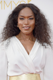 Angela Bassett wore her hair in a shock of curls during the Emmys.