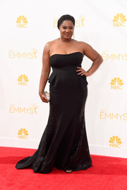 Adrienne C. Moore kept it classic and sexy at the Emmys in a black strapless gown.