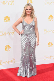 Amy Poehler went for Art Deco glamour in a fully sequined silver gown by Theia during the Emmys.