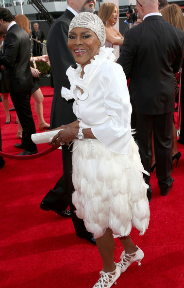 Cicely Tyson paired her blouse with a white feather skirt for an even more frilly look.