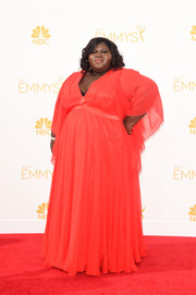 Gabourey Sidibe attended the Emmys wearing a flowy red gown with a deep-V neckline.