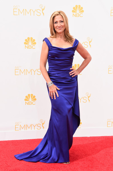 Edie Falco attended the Emmys looking sophisticated in a ruched purple gown.