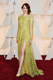 Emma Stone was sexy and sophisticated in a sheer-illusion, beaded chartreuse gown by Elie Saab Couture, featuring a hip-high slit and an open back, during the Oscars.