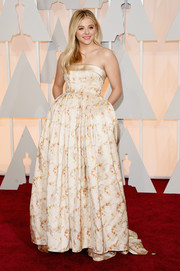Chloe Grace Moretz was fun and flirty at the Oscars in a champagne Miu Miu floral strapless gown with an exaggeratedly flared waist.