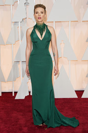 Scarlett Johansson vamped it up at the Oscars in a figure-hugging emerald gown by Atelier Versace, featuring a statement-making Swarovski crystal-embellished neckline.