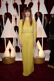 Andrea Riseborough was sporty-glam at the Oscars in a yellow Jenny Packham gown rendered in beaded stripes.