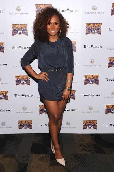 Janet Mock chose a deep navy frock with three quarter-length sleeves and a cinched waist for her look at ADCOLOR Live!