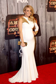 Carrie Underwood showed off her refreshingly modern maternity style with this white and gold Ashdon gown at the American Country Countdown Awards.