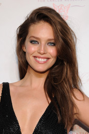 Emily DiDonato wore her hair teased with a deep side part when she attended the Angel Ball.