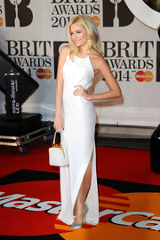 Pixie Lott kept the minimalist theme going with a pair of simple gray pumps by Sophia Webster.
