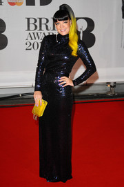 Lily Allen glittered in a vintage midnight-blue sequined gown by Norrell during the Brit Awards.